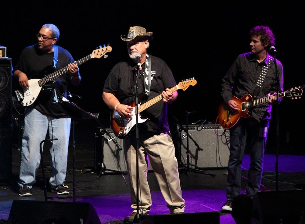 Jim Hogan playing at benefit concert